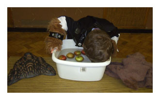 Ducking for apples at Halloween